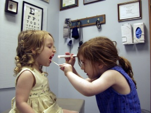 two little girl's playing doctor